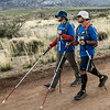 Tim and Nate use their white canes on the sandy road during the last mile of the hike.