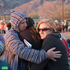 Dan Standage and his family hugging each other for love and warmth prior to the opening ceremony of the Bataan Death March.