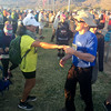 Lonnie Bedwell dances with a participant of the Bataan Death March.