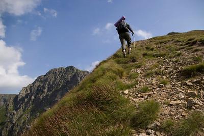 Steeper and steeper towards the peak.