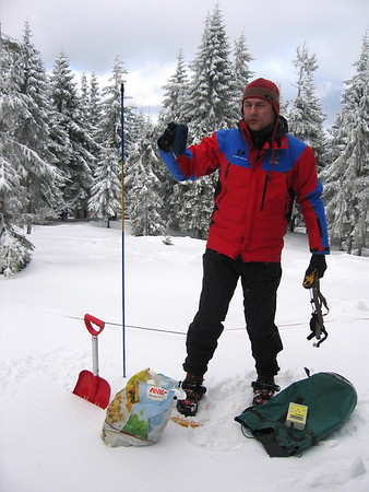 GOPR mountain rescuer demonstrating an avalanche detector