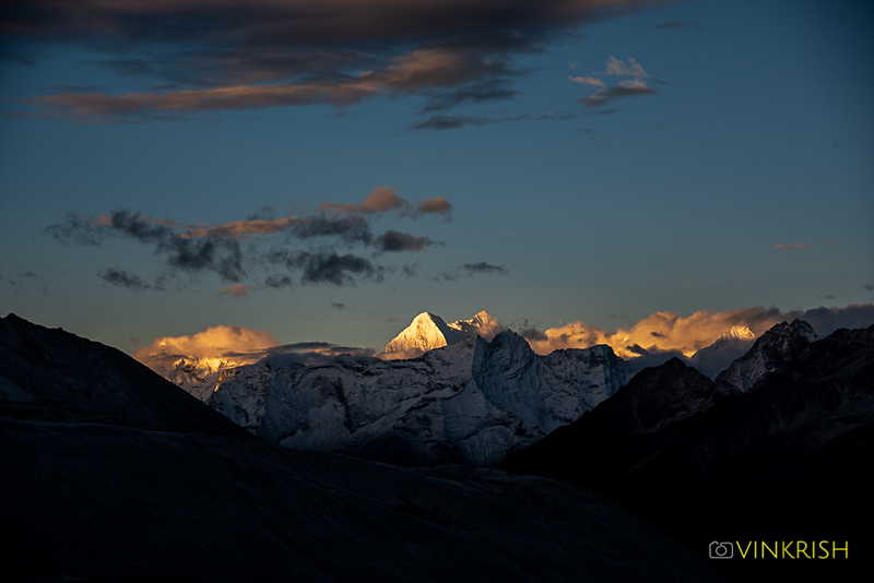 The sun hits the taller peaks and lights them up first
