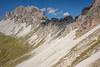 Those immense piles of scree are a testament to the friable quality of limestone as opposed to granite