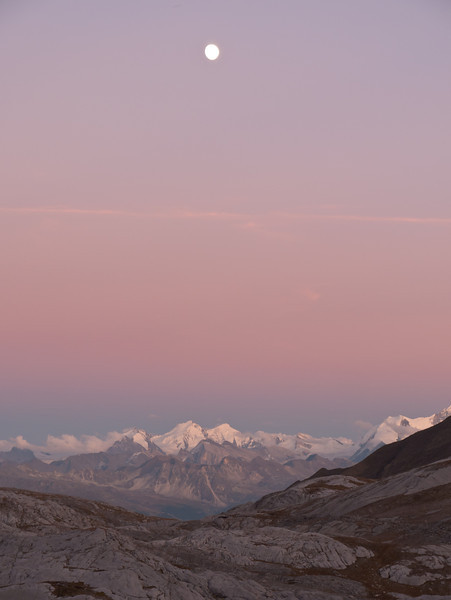 From the Cabane des Audannes, the full moon rises over the Rhone Valley, the Dom and the Taeschhorn