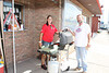 Jennifer Strawsine serving a hot dog to William Seymour