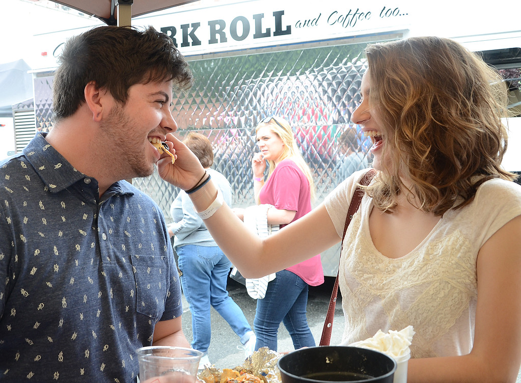 . Jessica Nesspor(r)feeds her husband Branndon some Mexiican food at the 2017 Trenton Pork Roll Festival at Trenton Social on Saturday . gregg slaboda photol