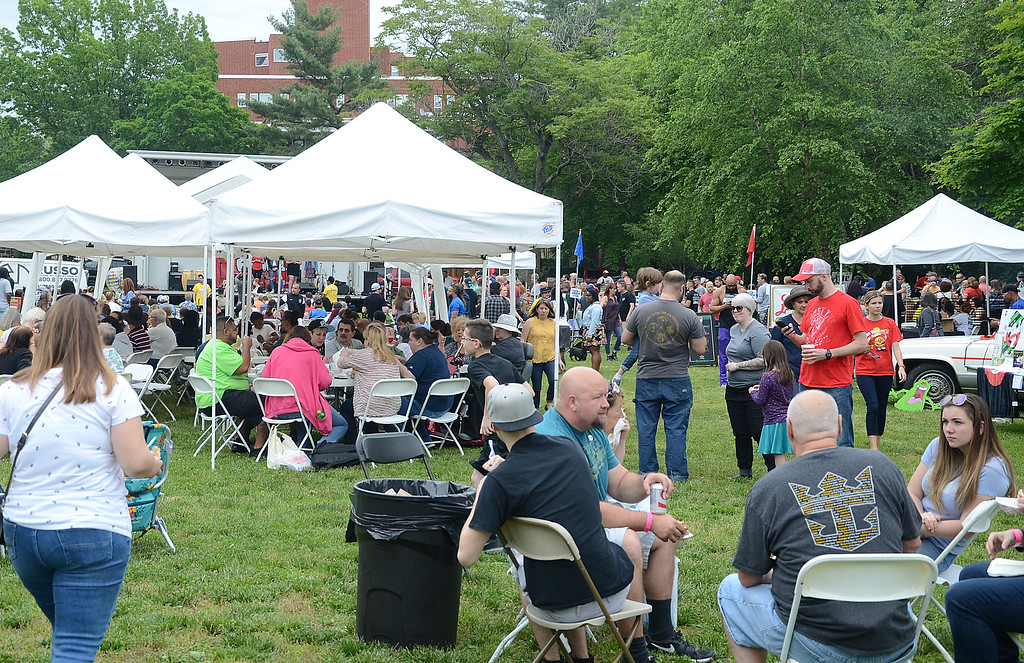. A big crowd wanders through Mill Hiil Park at the Official 4th Annual Pork Roll Festival on Saturday. gregg  slaboda photo