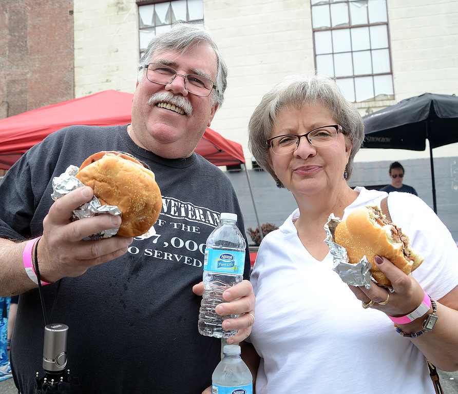 . Bob McNamara(l)and his wife Gloria enjoy the pork roll sandwichs at the 2017 Trenton Pork Roll Festival at Trenton Social. gregg slaboda photo