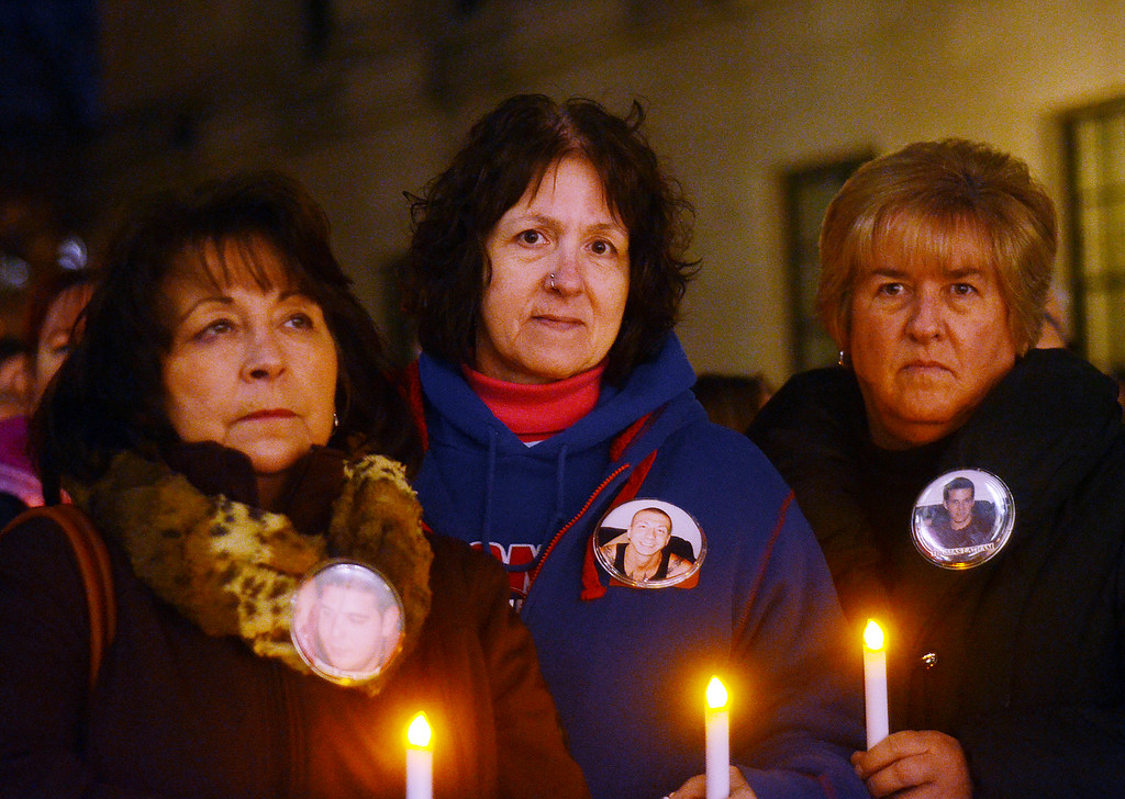 . L-R- Mary Mosner,Nancy Dempsey and Laurie Latham all lost a son to addiction attend   the 2nd Annual Candlelight  Vigil outside the state house to remember loved ones lost to addiction. gregg slaboda  photo
