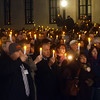 People hold candles up at the 2nd Annual Candlelight Vigil outside the state house in Trenton  to remember loved ones lost to addiction. gregg slaboda photo