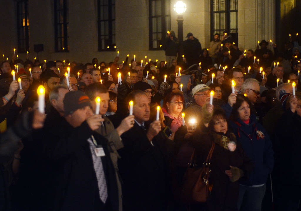 . People hold candles up at the 2nd Annual Candlelight Vigil outside the state house in Trenton  to remember loved ones lost to addiction. gregg slaboda photo