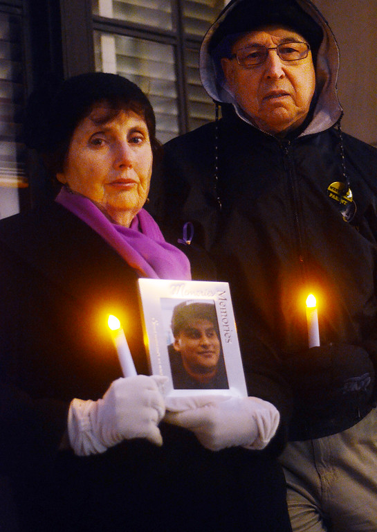 . Maragaret and Ted Superior attend the 2nd Annual  Candlelight Vigil outside the state house to remember loved ones lost to addiction. Maragaret holds a photo of their son Christopher who they lost to addiction. gregg slaboda photo