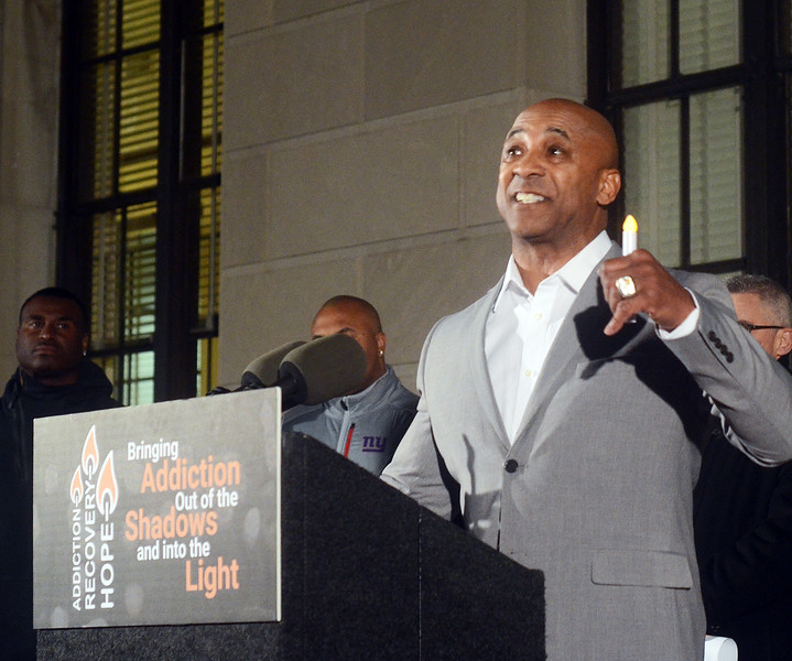 Trenton native and former NFL player for the Denver Broncos  speaks abourt his addiction at the 2nd Annual Candlelight Vigil on Wednesday. gregg slaboda photo