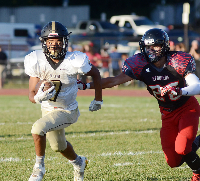 . Hopewell Elijah-Blu Wilmott(l)picks up yardage  as Allentown`s  Joe Dippolito tries  to make the tackle. gregg slaboda photo