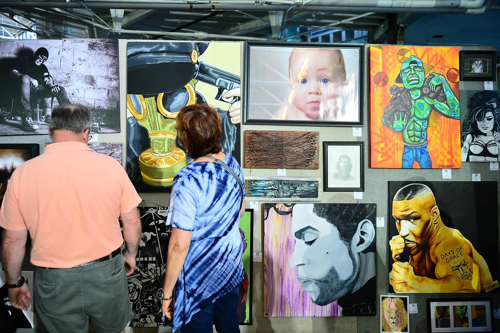 . Attendees admire various works of art at Art All Night in Trenton on June 18, 2016. (For The Trentonian - Scott Ketterer)