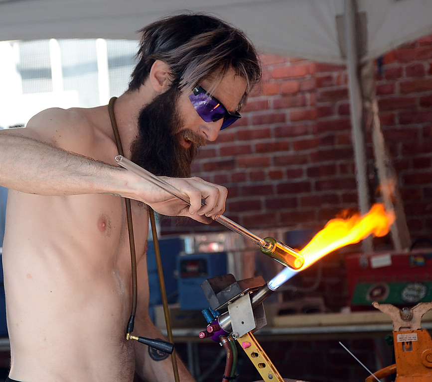 . Glass blower Nick Toth works on his creation at Art All Night. gregg slaboda photo