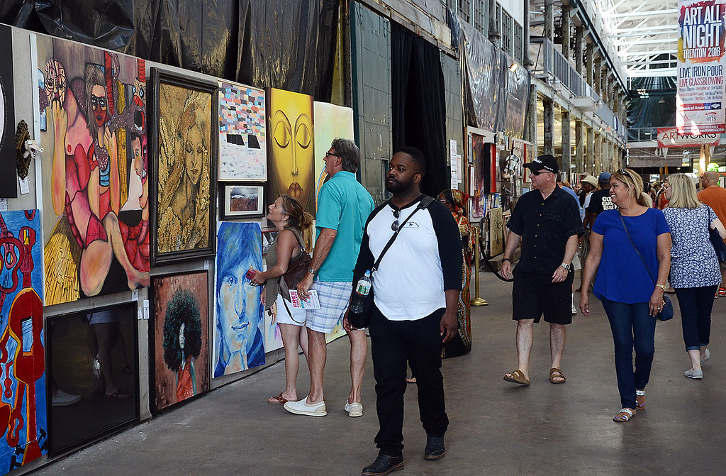 . Peolpe look over the art work at Art All Night on Saturday. gregg slaboda photo