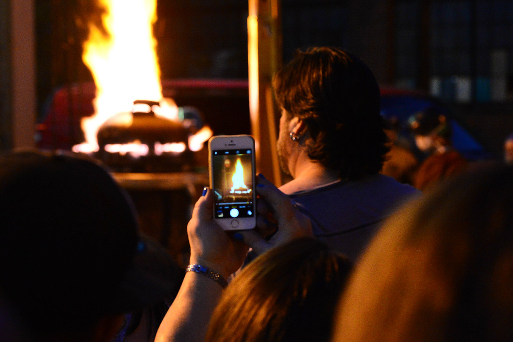 . An attendee snaps a photo of the Abominog forge at Art All Night. (For The Trentonian - Scott Ketterer)