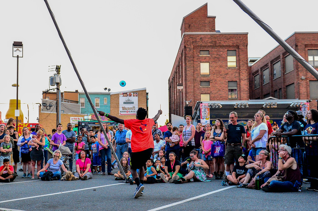 . A Trenton Circus performer wows the crowd at Art All Night on June 18, 2016. (For The Trentonian - Scott Ketterer)