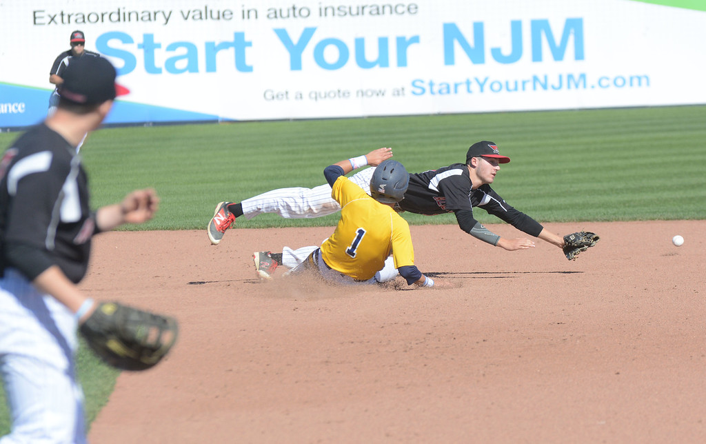 . Allentown�s Jackson Fogarty dives for a throw as Nottingham�s Brien Cardona slides into second.