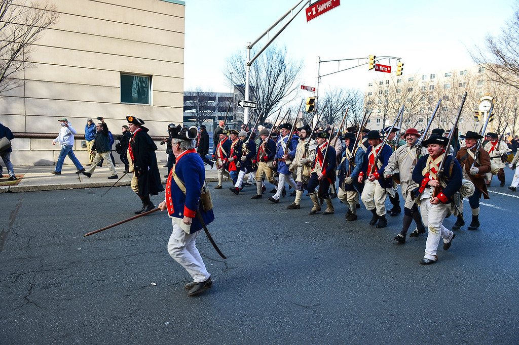 . Colonial Soldiers advance down Warren Street toward  battle with British and Hessian troops during the First Battle of Trenton On Saturday Dec. 31, 2016. (Scott Ketterer - The Trentonian)