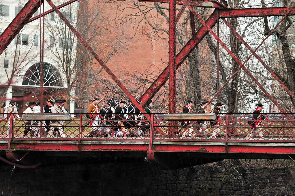 . Colonial Army reenactors cross the Assunpink by bridge during the Second Battle of Trenton Reenactment in Mill Hill Park on Saturday Dec. 31, 2016. (Scott Ketterer - The Trentonian)