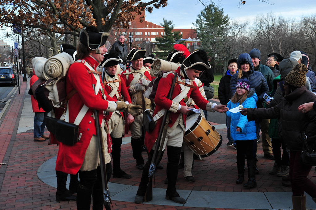 . British Troops pass out literature to attendees during the Second Battle of Trenton in Mill Hill Park on Dec. 31, 2016. (Scott Ketterer - The Trentonian)