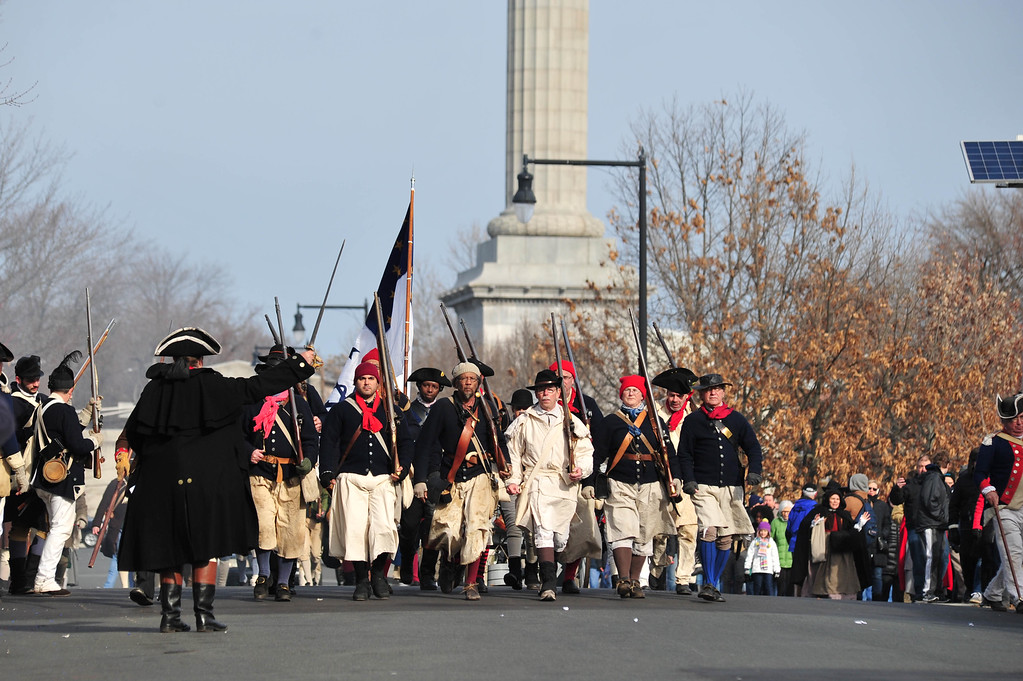 . Colonial Soldiers advance from the base of the Battle Monument toward  battle with British and Hessian troops during the First Battle of Trenton On Saturday Dec. 31, 2016. (Scott Ketterer - The Trentonian)