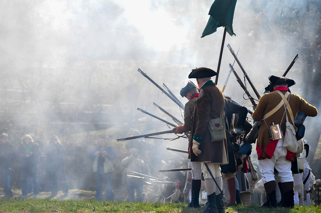 . Soldiers reload their weapons amid the fog of war during in Mill Hill Park during the First Battle of Trenton on Saturday Dec. 31, 2016 (Scott Ketterer - The Trentonian)