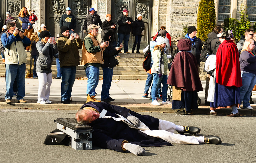 . A reenactor lies dead as a casualty during theFirst Battle of Trenton on Saturday Dec. 31, 2016. (Scott Ketterer - The Trentonian)