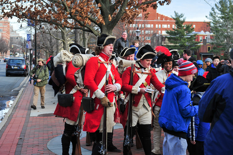 British Troops pass out literature to attendees during the Second Battle of Trenton in Mill Hill Park on Dec. 31, 2016. (Scott Ketterer - The Trentonian)
