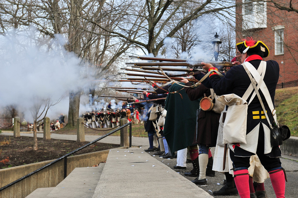 . Colonial Army reenactors return fire during the Second Battle of Trenton Reenactment in Mill Hill Park on Saturday Dec. 31, 2016. (Scott Ketterer - The Trentonian)