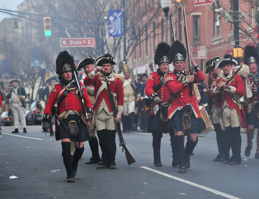 . Reenactors dressed as Redcoats  battle with Colonial Soliders during the Second Battle of Trenton on Saturday Dec. 31, 2016. (Scott Ketterer - The Trentonian)