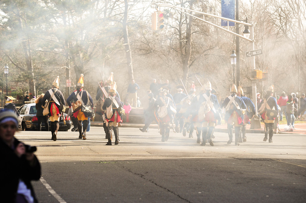 . Hessians scramble toward Mill Hill Park during the First Battle of Trenton Reenactment on Dec. 31, 2016 (Scott Ketterer - The Trentonian)