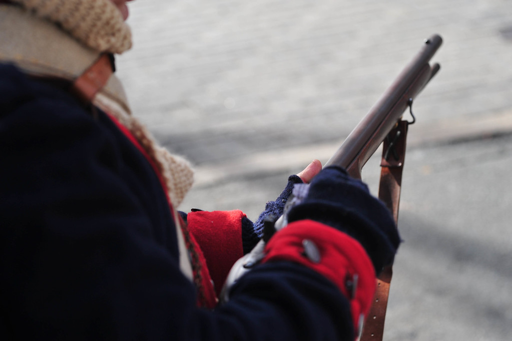 . A reenactor loads gunpowder into his musket\'s flashpan during the First Battle of Trenton Reenactment on Saturday Dec. 31, 2016. (Scott Ketterer - The Trentonian)