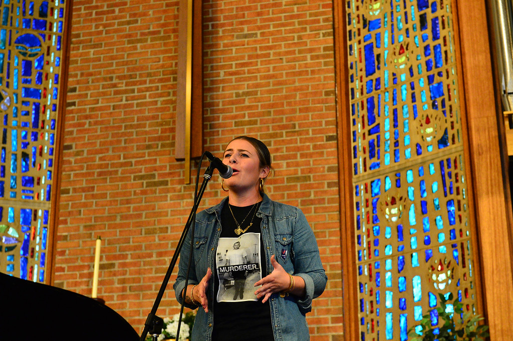 . Caitlin Fair performs a spoken word piece during the Concert to End Gun Violence in Ewing on Sunda Sept. 25, 2016 (Scott Ketterer -- The Trentonian)