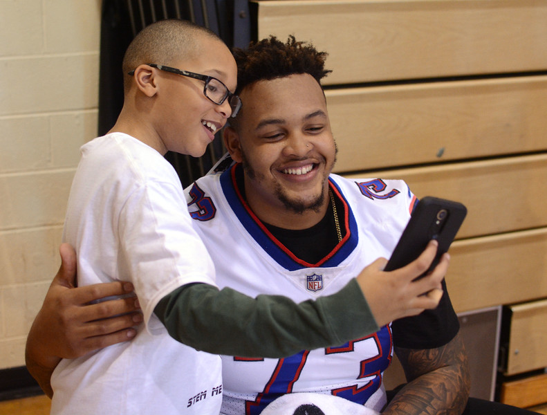 Dion Dawkins poses for a photo with Grice Middle School sixth-grader Aaron Williams during a visit to the Hamilton school on Friday. <br /> John Berry — The Trentonian