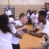 Joe Radoslovich, center, a sixth-grade student at Grice Middle School celebrates with other students after he won a game of knockout basketball with Rider University basketball players and NFL offensive lineman Dion Dawkins Friday.<br /> John Berry — The Trentonian