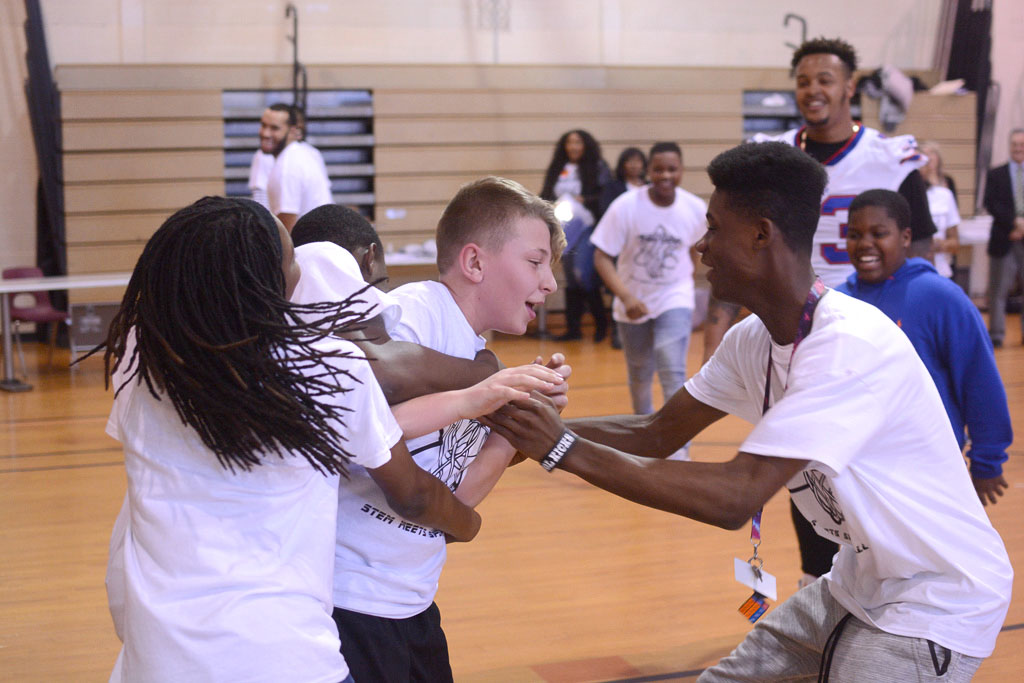 . Joe Radoslovich, center, a sixth-grade student at Grice Middle School celebrates with other students after he won a game of knockout basketball with Rider University basketball players and NFL offensive lineman Dion Dawkins Friday.