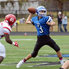 Ewing`s Jacob Basich(r)throws a pass against Lawrence. gregg slaboda photo