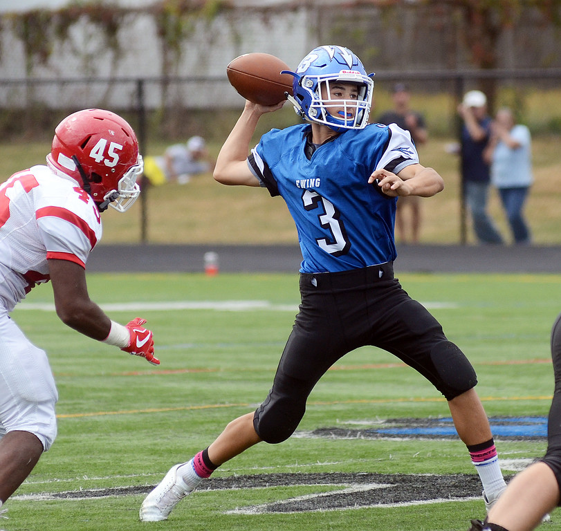 . Ewing`s Jacob Basich(r)throws a pass against Lawrence. gregg slaboda photo