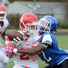 Lawrence`s Sean McLaughlin(l)pulls in a pass defended by Ewing`s Terrance StokesII. gregg slaboda photo