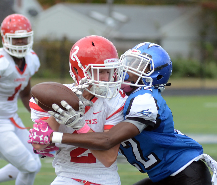 . Lawrence`s Sean McLaughlin(l)pulls in a pass defended by Ewing`s Terrance StokesII. gregg slaboda photo
