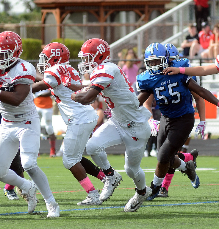. Lawrence`s Davon Hemingway(10) carries the ball against Ewing. gregg slaboda photo