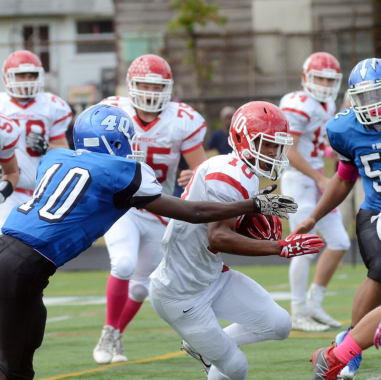 . Lawrence`s Davon Hemingway(10) looks for running room against Ewing. gregg slaboda photo