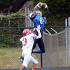 Ewing `s Justin Reed(6) pulls down a pass against Lawrence. gregg slaboda photo. gregg slaboda photo