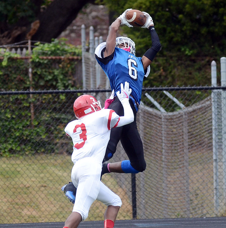 . Ewing `s Justin Reed(6) pulls down a pass against Lawrence. gregg slaboda photo. gregg slaboda photo