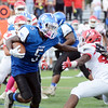 Ewing`s Edamiyon Doggett(l) carries the ball against Lawrence. gregg slaboda photo