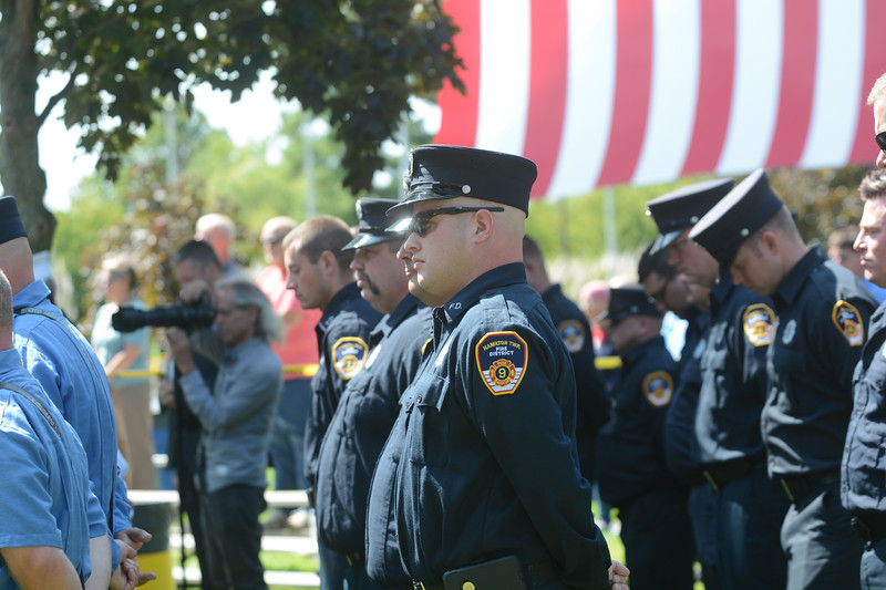 Firefighters listen during the September 11th memorial service in Veterans Park Monday on the 16th anniversary of the September 11th terrorist attacks.<br /> John Berry - The Trentonian