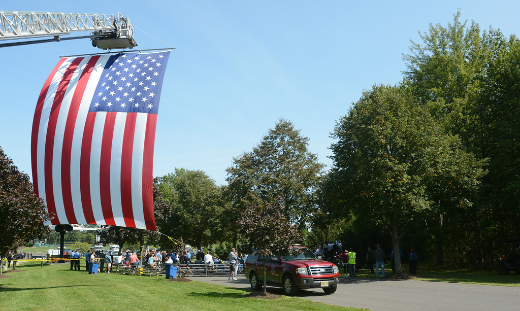 . Hamilton Fire Department hoisted a giant American flag  for the September 11th memorial service in Veterans Park Monday on the 16th anniversary of the September 11th terrorist attacks.